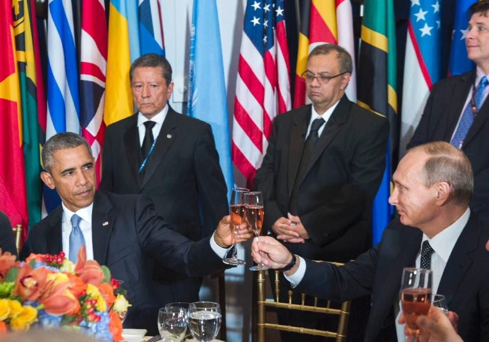 A Frowning Obama Toasts Putin